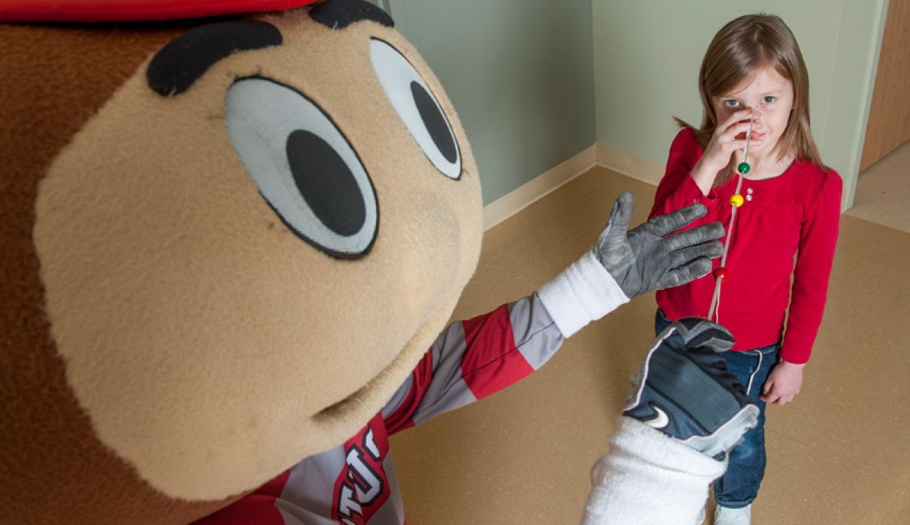 Brutus Buckeye with pediatric patient