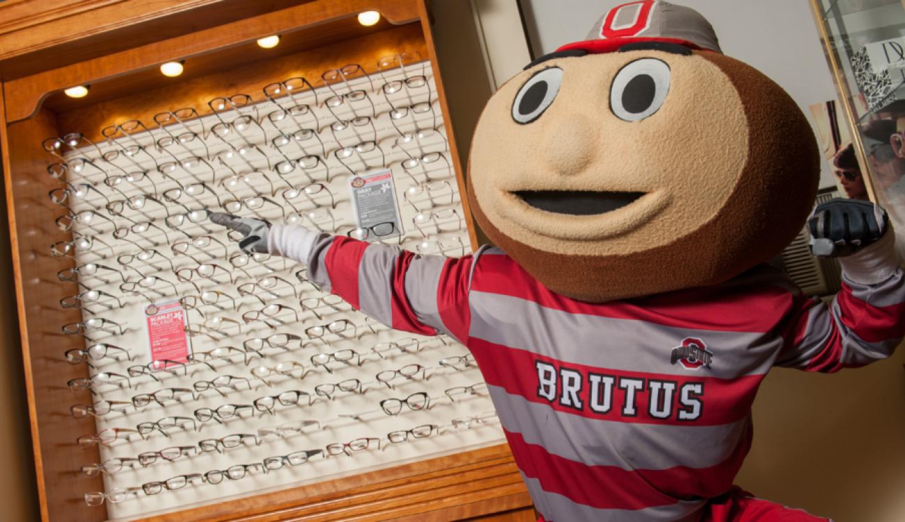 Brutus Buckeye showing the student glasses deals at the Eyewear Gallery.